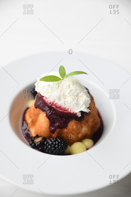 A gourmet blackberry pastry served in a restaurant