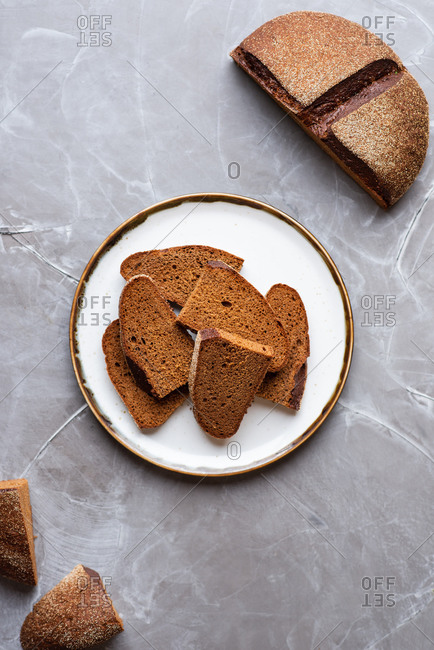 Sliced rye sourdough bread over gray background