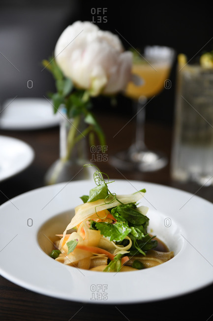 Small gourmet pasta dish served in a restaurant