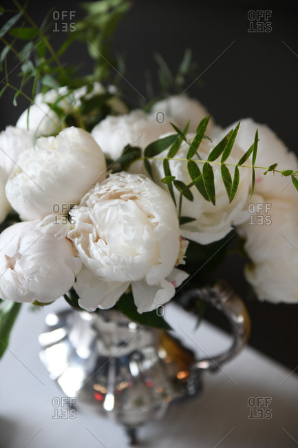 White peony arrangement in a silver vase