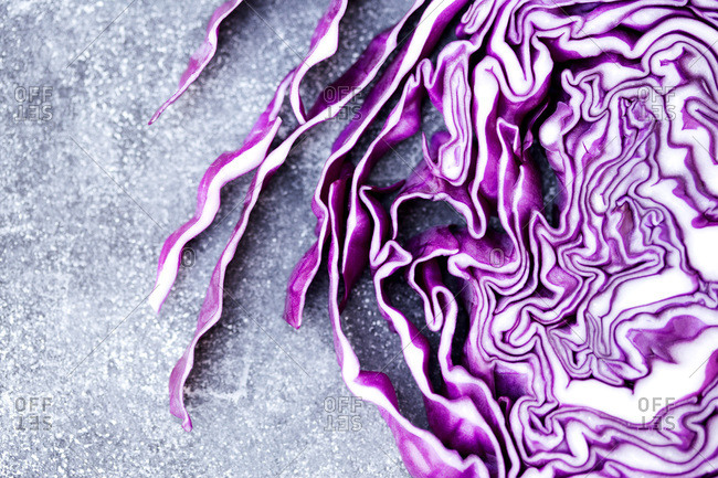 Red cabbage chopped in slice on gray background
