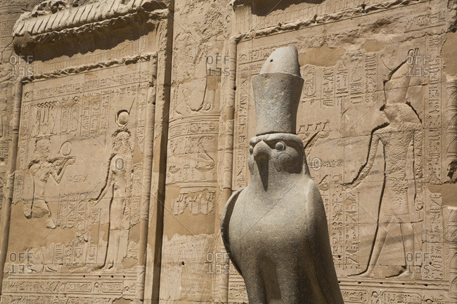 March 16, 2020: Statue of Falcon, Front of First Pylon, Temple of Horus, Edfu, Egypt, North Africa, Africa
