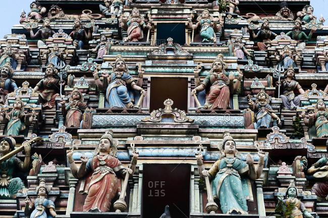 Hindu gods adorn the five story Raja Gopuram, Sri Mahamariamman Hindu Temple, Kuala Lumpur. Malaysia, Southeast Asia, Asia
