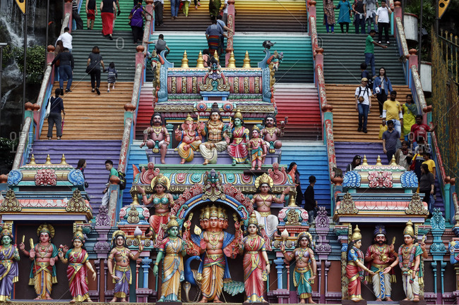 December 15, 2019: Entrance through the colorful staircase of the Hindu Temple and Shrine of Batu Caves, Kuala Lumpur, Malaysia, Southeast Asia, Asia