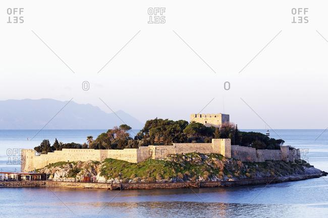 The Byzantine era fortress on Guvercin Ada (Pigeon Island), looking into the Aegean Sea, in the harbor of Kusadasi, Turkey, Asia Minor, Eurasia