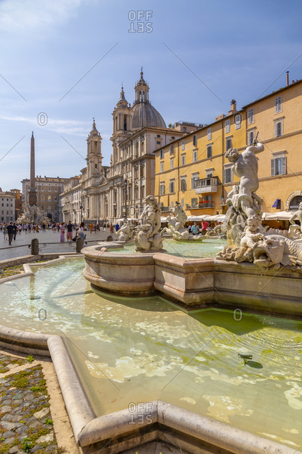 September 15, 2019: View of the Neptune Fountain and colorful architecture in Piazza Navona, Piazza Navona, UNESCO World Heritage Site, Rome, Lazio, Italy, Europe