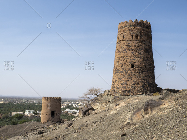 Remains of the mud and clay watch towers in the village of Mudayrib, Sultanate of Oman, Middle East