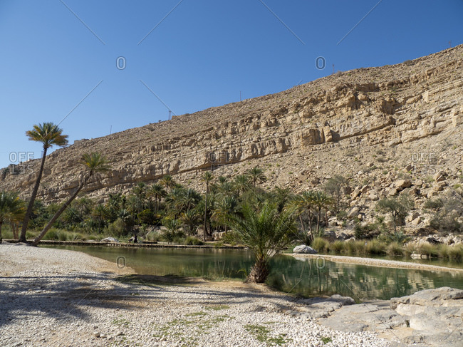 Natural swimming pools formed by flood waters in Wadi Bani Khalid, Sultanate of Oman, Middle East