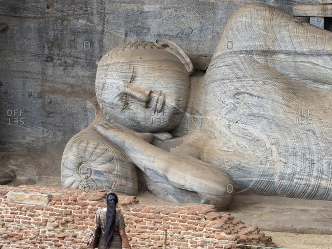 The reclining Buddha figure inside Gal Viharaya, UNESCO World Heritage Site, Polonnaruwa, Sri Lanka, Asia