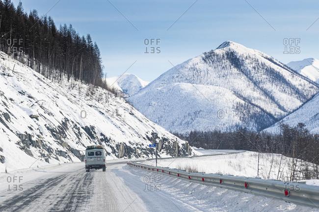 March 7, 2020: Minivan driving on the Road of Bones, Suntar-Khayata Range, Sakha Republic (Yakutia), Russia, Eurasia