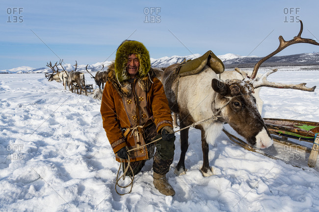 March 8, 2020: Evenk reindeer breeder with reindeers, Oymyakon, Sakha Republic (Yakutia), Russia, Eurasia