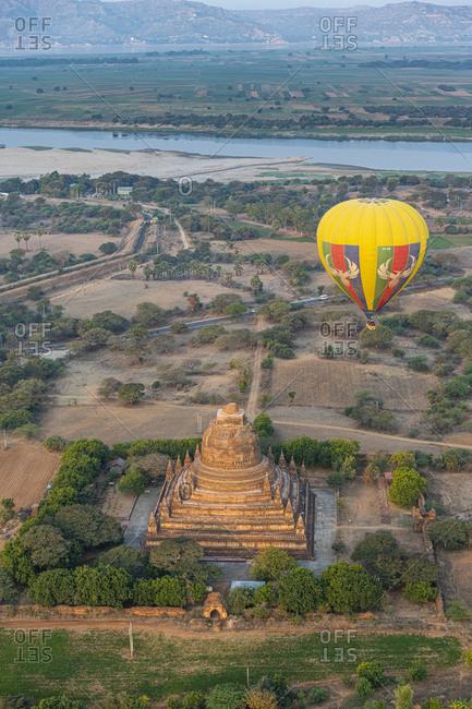 February 6, 2020: Hot air balloon at sunrise over a temple, Bagan (Pagan), Myanmar (Burma), Asia