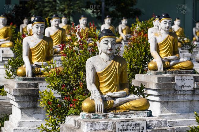 January 6, 2020: Buddhas lining up, Aung Zay Yan Aung Pagoda, Myitkyina, Kachin state, Myanmar (Burma), Asia