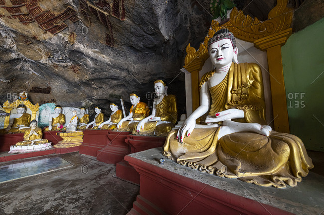 Cave filled with buddhas, Kawgun Cave, Hpa-An, Kayin state, Myanmar (Burma), Asia