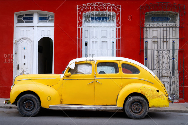 March 8, 2020: Old classic yellow car, Cienfuegos, Cuba, West Indies, Caribbean, Central America