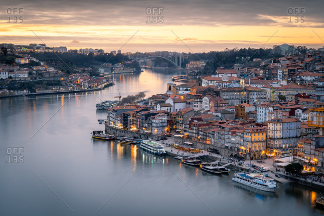 February 14, 2020: Sunset over Porto looking towards the Ribeira district from the Dom Luis I Bridge, UNESCO World Heritage Site, Porto, Portugal, Europe
