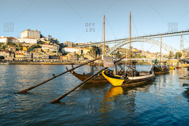 February 17, 2020: Boats of the Port Bodegas on the Douro River looking towards the Ribeira district of Porto, Portugal, Europe