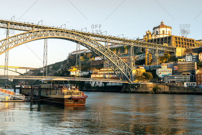 February 17, 2020: The Dom Luis I Bridge at sunset looking towards the Monastery of Serra do Pilar, UNESCO World Heritage Site, Porto, Portugal, Europe