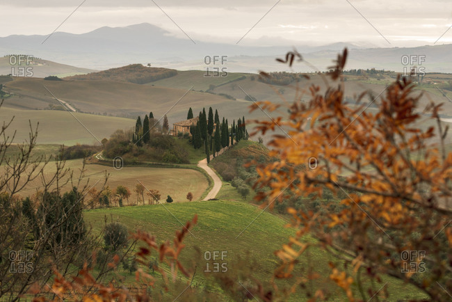 December 7, 2019: Podere Belvedere and Tuscan countryside at dawn near San Quirico d'Orcia, Tuscany, Italy, Europe