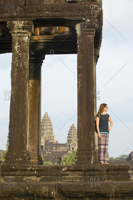 November 19, 2014: Female tourist gazing out at the Angkor archaeological complex, UNESCO World Heritage Site, Siem Reap, Cambodia, Indochina, Southeast Asia, Asia
