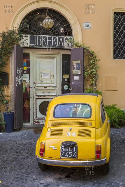 July 31,  2016: Library and Fiat 500, city district Monti, Rione, Rome, Lazio, Italy