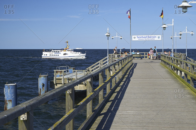 July 22,  2016: Pier and ship Adler, Baltic Sea resort of Bansin, Usedom, Mecklenburg Western Pomerania, Germany