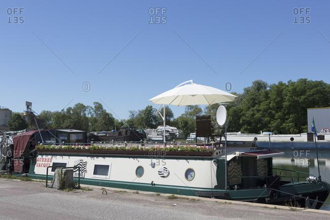 June 21,  2016: Houseboat Quire Jacqui, Saint-Jean-de-Losne, Burgundy Canal, Burgundy, France