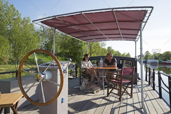 May 7,  2016: Houseboat Zirius, Saint-Jean-de-Losne, Burgundy Canal, Burgundy, France