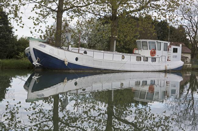 April 28,  2016: Houseboat, Canal de Bourgogne, Saint-Jean-de-Losne, Burgundy, France
