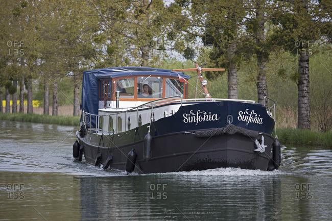 April 21,  2016: Houseboat, Canal de Bourgogne, Saint-Jean-de-Losne, Burgundy, France
