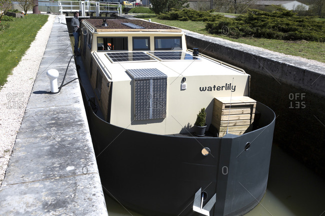 April 18,  2016: Houseboat Waterlily, Pouilly-en-Auxois, Burgundy Canal, Burgundy, France