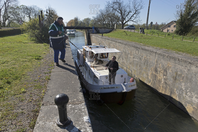 April 18,  2016: Houseboat in Sluice, Burgundy Canal, Saint-Jean-de-Losne, Burgundy, France