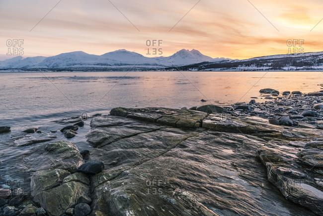 Sunset on the coast near Tisnes on Kvaloya, Norway Sunset on the coast near Tisnes at Kvaloya island, Norway