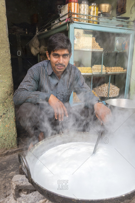 February 7,  2016: Milk is boiled down in a large pot to make sweets, Nawalgarh, Rajasthan, India. Milk is cooked in a large pot to prepare desserts, Nawalgarh, Rajasthan, India