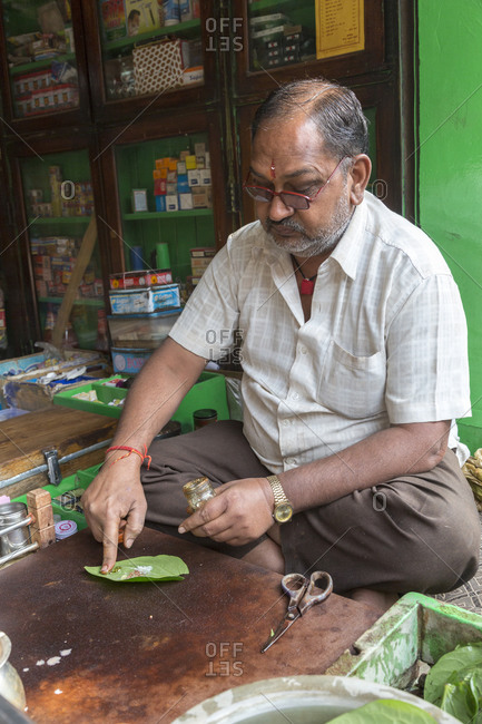 February 7,  2016: Pan preparation at a street stall in Ayurvedic Medicine, India. They are chewed together with slaked lime, spices and betel nut, Nawalgarh, Rajasthan, India