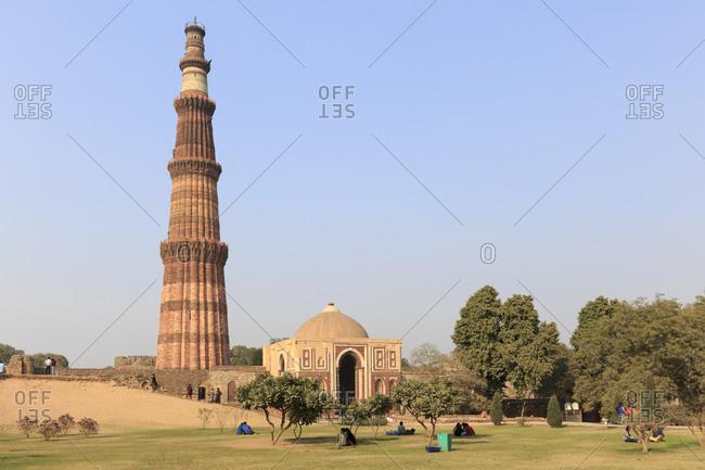 February 5,  2016: Victory Column Qutb Minar and Qutb Complex, Delhi, India Tower Qutb Minar and Qutb Complex, Delhi, India