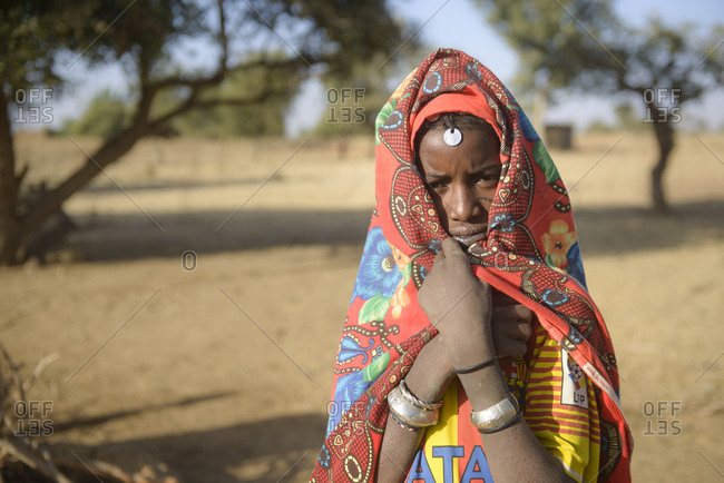 December 20,  2015: Fulani women gathering water from a hole in the Sahel, Burkina Faso