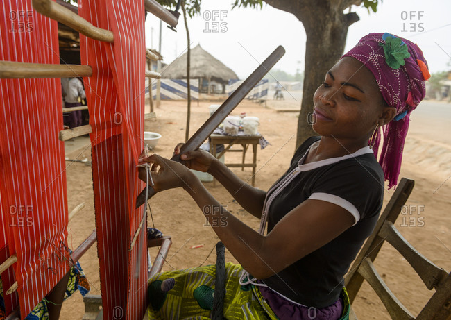 December 4,  2015: Girls and women working on their looms in a village of northern Benin, Africa