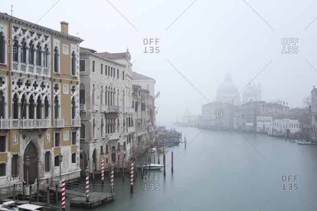 The Grand Canal with the Church of Santa Maria della Salute in fog, Venice, Italy