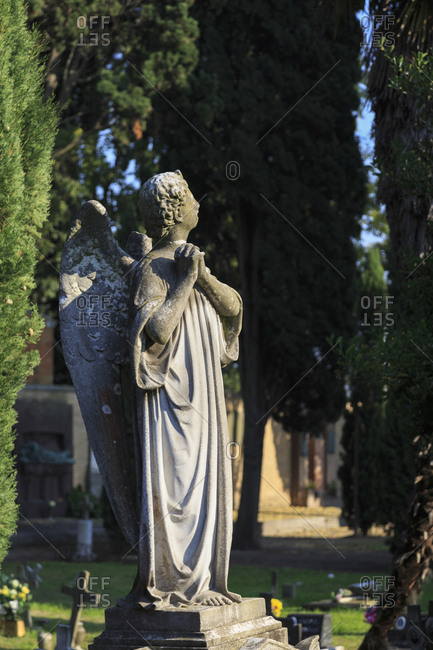 Statue, cemetery on the island of San Michele, Venice, Italy