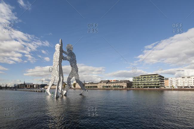 September 29,  2015: Spreeufer Kreuzberg, Molecule Man, sculpture by Jonathan Borofsky in the Spree between Kreuzberg, Friedrichshain and Alt-Treptow, Berlin, Germany