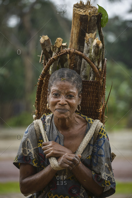 September 23,  2015: Woman with basket, Gabon, Central Africa