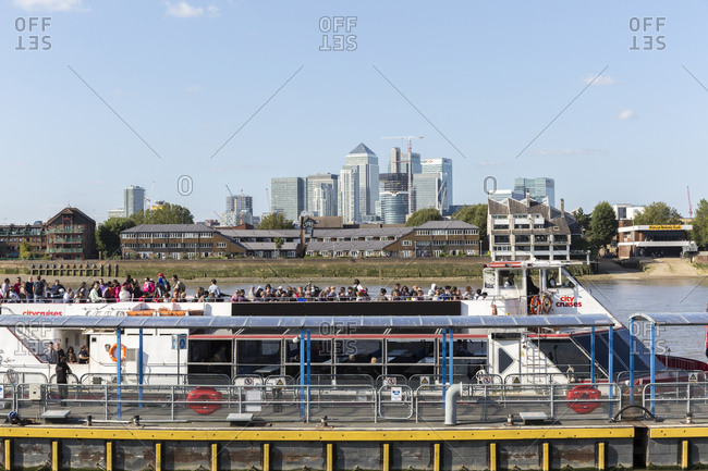 September 6,  2015: View from Greenwich Pier to the skyscrapers of Canary Wharf on the Isle of Dogs, Tower Hamlets, London, United Kingdom