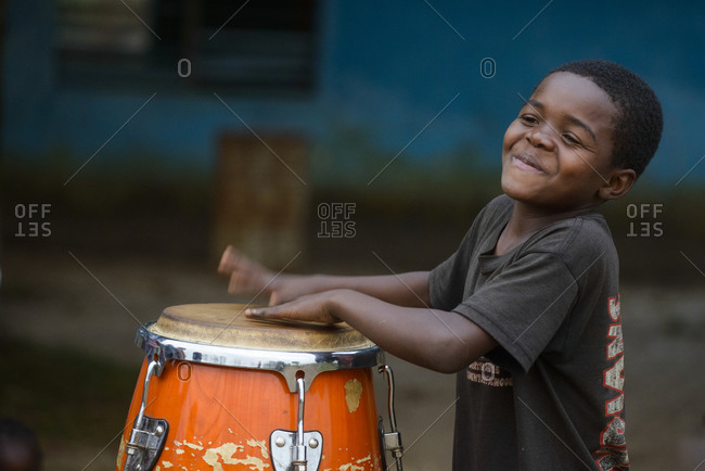 September 5,  2015: Boy playing on a drum, Democratic Republic of Congo, Africa