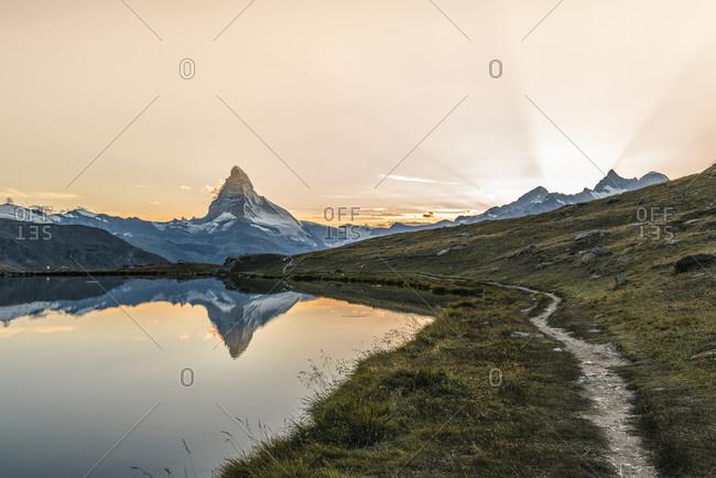 The Matterhorn reflected in Stellisee at sunset, Switzerland