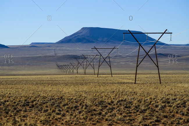 Electricity pylon by the namibian desert, Namibia, Africa