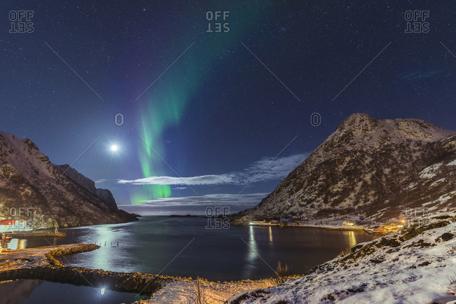The moon and northern lights illuminate the Straumfjord, the bay of Straume on Veteran, Norway