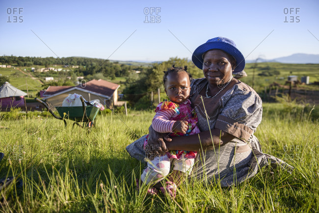 February 9,  2015: Elderly woman with baby from Zulu tribe, Kwazulu Natal, South Africa