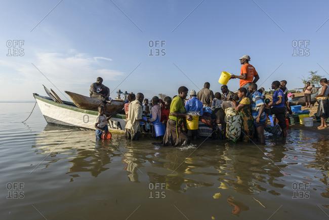 November 21,  2014: People on fish market on Lake Malawi, Malawi, Africa People on open-air fish market at Lake Malawi, Malawi, Africa
