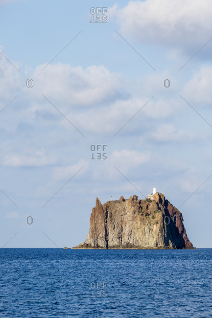 The Strombolicchio, the volcanic island of Stromboli offshore rocky island, Aeolian Islands, Sicily, Italy